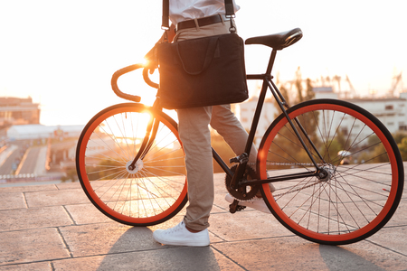 Photo for Cropped photo of young african man early morning with bicycle outdoors. - Royalty Free Image