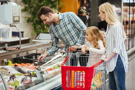 Foto für Happy family with child buying food at supermarket - Lizenzfreies Bild