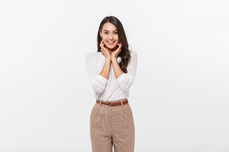 Foto de Portrait of a lovely asian businesswoman looking at camera isolated over white background - Imagen libre de derechos