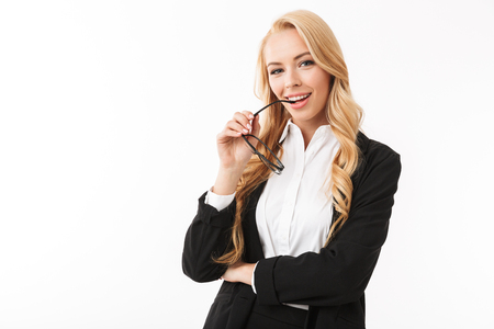 Photo pour Photo of european businesswoman wearing office suit smiling and holding eyeglasses isolated over white background in studio - image libre de droit