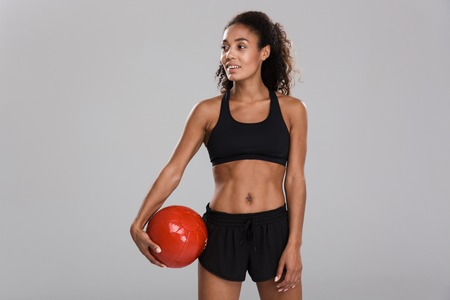Photo for Image of amazing young strong sports woman make exercises with ball isolated. - Royalty Free Image