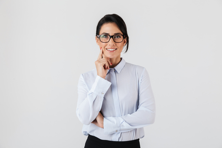 Photo for Photo of successful businesswoman wearing eyeglasses standing in the office isolated over white background - Royalty Free Image