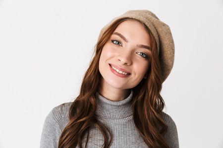 Photo for Portrait closeup of beautiful woman 30s wearing hat smiling and looking at you isolated over white background - Royalty Free Image