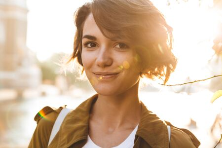 Photo for Image of a cute young amazing woman walking outdoors in park in beautiful spring day. - Royalty Free Image