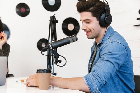 Photo for Two radio hosts moderating a live show for radio - Royalty Free Image
