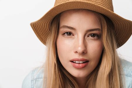 Photo pour Image of serious amazing young pretty woman wearing hat posing isolated over white wall background looking camera. - image libre de droit