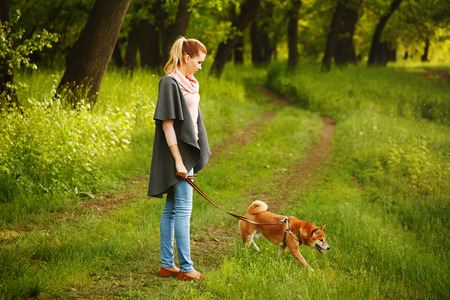 girl and dog walking in Spring Park.