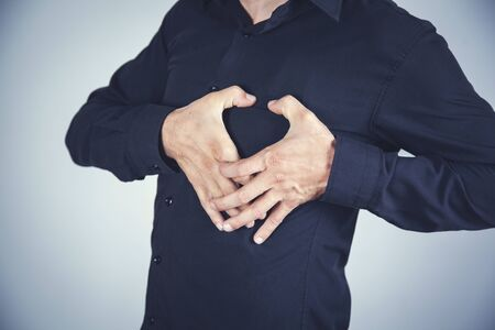 Photo for man hand in heart on the gray wall background - Royalty Free Image