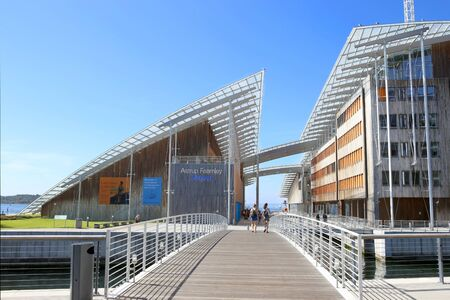 Foto de Oslo, Norway - July 24, 2018: Astrup Fearnley Museum of Modern Art. Astrup Fearnley Museum is a contemporary art gallery connects canals in the waterfront of Oslo in Aker Brygge district. Museum designed by Renzo Piano. It consists of two buildings. - Imagen libre de derechos