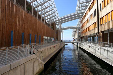 Foto de Oslo, Norway - July 24, 2018: View of Astrup Fearnley Museum of Modern Art. Astrup Fearnley Museum, contemporary art gallery in Aker Brygge district. Museum designed by Renzo Piano. It consists of two buildings. - Imagen libre de derechos