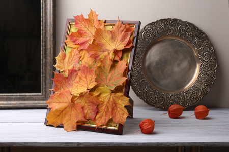 Foto de Autumn decoration in interior. Chinese lantern on wooden shelf. - Imagen libre de derechos