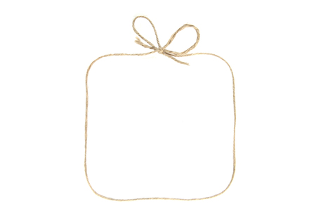 Foto de Rectangular  frame with bow as gift box made of string isolated on white background. Empty frame made of linen twine or rope. - Imagen libre de derechos