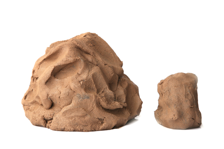 Foto de Natural clay piece isolated on white background. Wet clay material for sculpting or modeling. - Imagen libre de derechos
