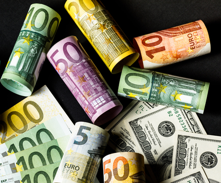 Concept of currency exchange trading. . Roll of Hundred us dolla