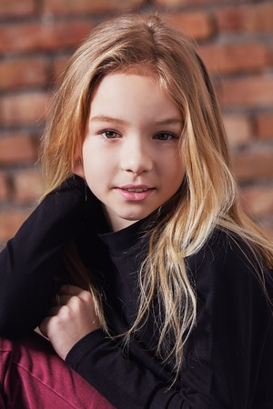 closeup portrait fashion kid girl. Stylish young model child blond hair. pretty beauty female face small child. fashion concept. models tests caucasian appearance.