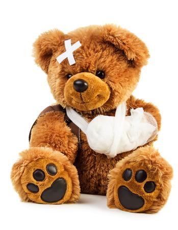 Teddy bear with bandage isolated on white background