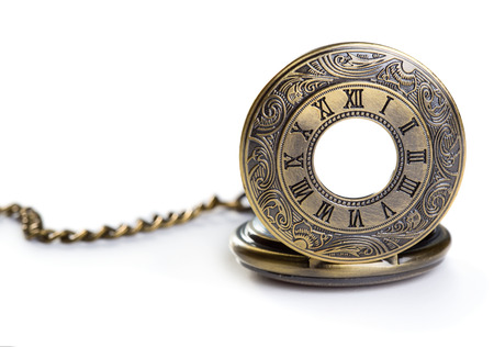 Old pocket watch isolated over white background
