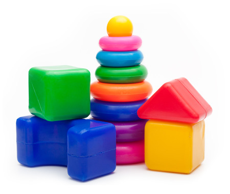Toys  isolated on white background. Pyramid build from colored rings and a building blocks.