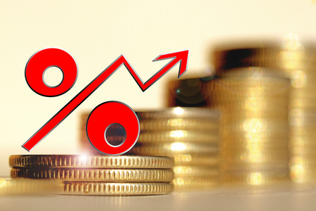 Red percent sign on a background of money. The concept of changes in Bank interest rates.