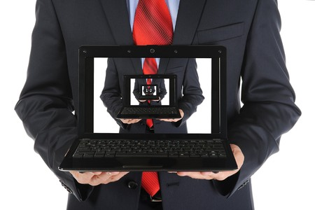 Foto de Businessman holding an open laptop. Isolated on white background - Imagen libre de derechos