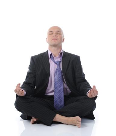 businessman meditating in yoga lotus. Isolated on white background