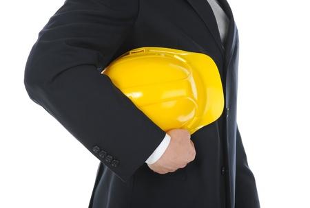 Businessman with construction helmet