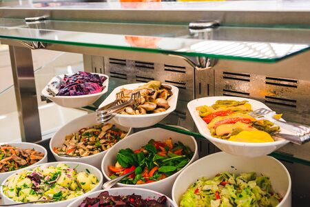 Photo pour buffet table with salats and  vegetables in big white plates. - image libre de droit