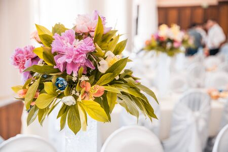 Photo for a bouquet of flowers in vase on served tables at the wedding. banquet concept - Royalty Free Image