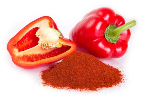 Foto de pile of ground paprika with pepper on white background - Imagen libre de derechos