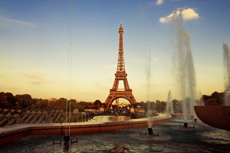 Eiffel Tower (La Tour Eiffel) with fountains. Beautiful sunset landscape in Paris.