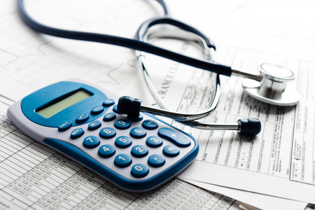 Photo pour Health care costs. Stethoscope and calculator symbol for health care costs or medical insurance - image libre de droit