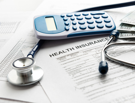 Photo for Health insurance form with stethoscope - Royalty Free Image