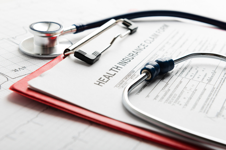 Photo pour Health insurance form with stethoscope - image libre de droit
