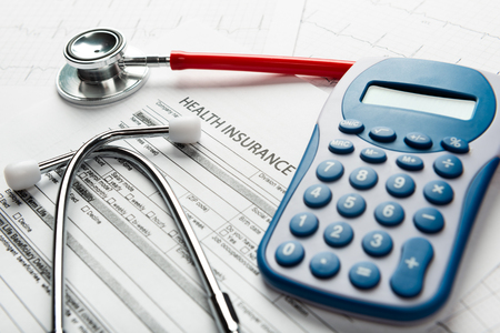 Photo pour Stethoscope and calculator symbol for health care costs or medical insurance - image libre de droit