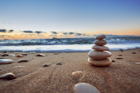 Stones balance on beach sunrise shot