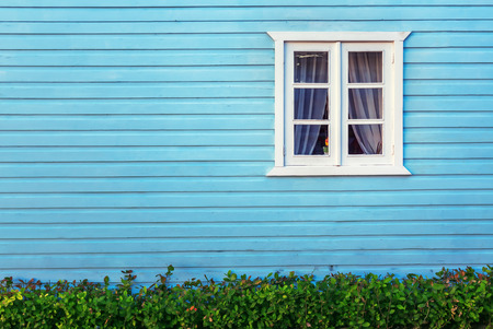 Decorative white window on an a blue  wooden wall in Punta Cana
