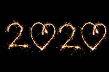 Photo pour 2020 written with Sparkle firework on black background, happy new year 2020 concept. - image libre de droit