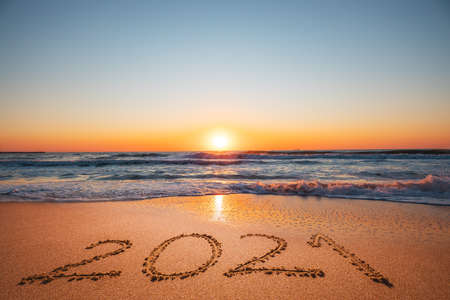 Photo for Happy New Year 2021 concept, lettering on the beach. Written text on the sea beach at sunrise. - Royalty Free Image