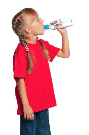 Photo pour Little girl with bottle of water - image libre de droit