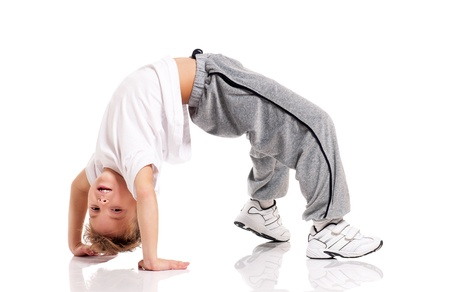 Happy little boy doing gymnastics isolated on white background