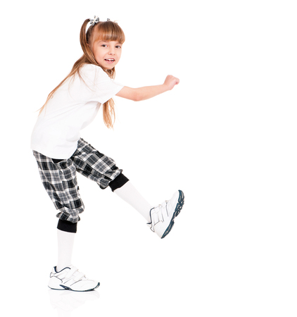 Little girl in white T-shirt dancing isolated on white background