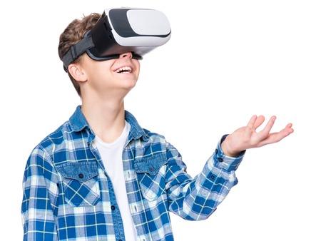 Photo pour Teen boy in VR glasses - image libre de droit