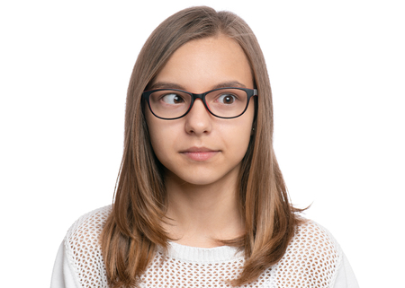 Photo for Crazy child making grimace - Silly face. Funny caucasian teen girl in eyeglasses, isolated on white background. Close-up portrait. - Royalty Free Image