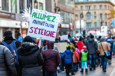Photo pour French sign seen in an ecological protest saying Light up before we switch off - image libre de droit
