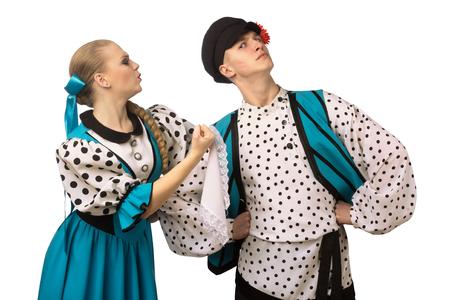 Foto de Beautiful caucasian girl swears with a guy n Russian folk costumes isolated on white background - Imagen libre de derechos