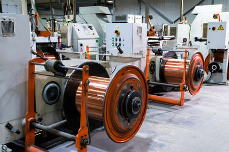 Photo pour Production of copper wire, bronze cable in reels at factory - image libre de droit