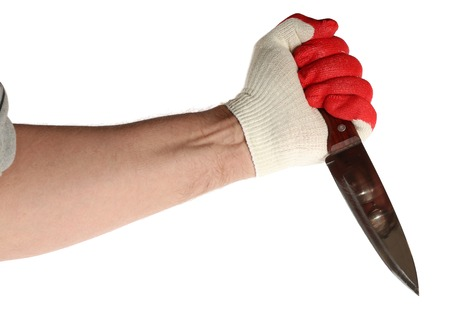 Hand in work gloves fingers painted as blood is holding a large knife. On a white background.