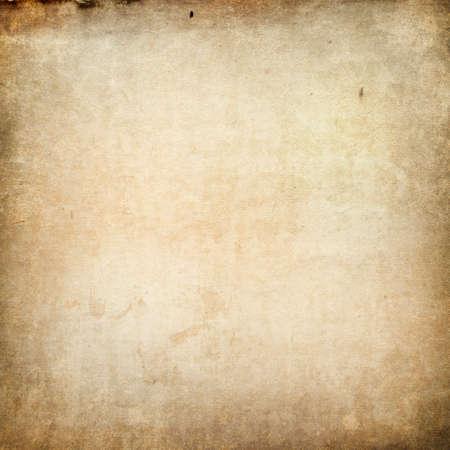 Foto de Texture of old faded vintage paper, beige retro background, grunge paper in spots and streaks with space for text - Imagen libre de derechos