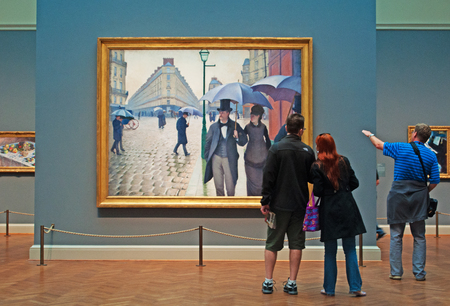 Looking at oil painting Paris Street Rainy Day by Gustave Caillebotte, Art Institute of Chicago
