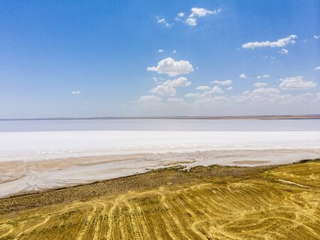 Aerial view of Lake Tuz, Tuz Golu. Salt Lake. White salt water. It is the second largest lake in the world and one of the largest hypersaline lakes in the world. It is located in the Central Anatolia Region, Ankara, Aksaray, Konya